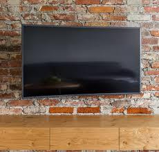 to mount a tv onto a brick wall