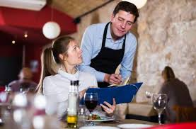 restaurant waiter taking order. Delighful Restaurant Hospitable Waiter Helping Young Girl With Menu Taking Order In Restaurant  Stock Photo  95454886 Throughout Restaurant Waiter Taking Order