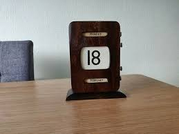 vintage wooden perpetual desk calendar with chrome winding knobs