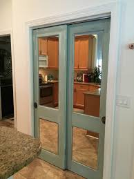 vintage wood doors with mirror added refinished with chalk paint and vintage hardware mirrored
