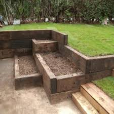 terraced garden boxes made from rustic railway sleepers