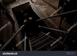 Scary Man Silhouette Dark Staircase Light Stock Photo - Creepy basement stairs