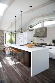 lighting for kitchens. our kitchen island modern lighting adds to the minimalist feel of this california home by abodwell for kitchens
