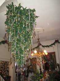 the tree has now been decorated with lights and some other decorations in addition to the crystal chandelier pieces that had been put on earlier in the day