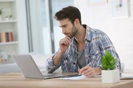 working for home office. Man Working From Home With Laptop And Taking Notes For Office