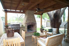 outdoor living room design with white wood chair and fire place