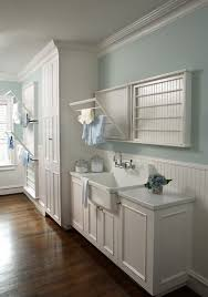laundry sink cabinet laundry room beach style with metal shelf bracket wicker baskets laundry sink cabinet laundry room traditional with wood floors beach style laundry room
