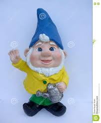 garden gnome with blue hat and dandelion