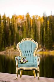 vine gold and aqua armchair with the brides bouquet modern glam autumn wedding in fig