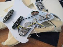diy making a fat strat for left handed guitarists fender i then created a diagram to show the electrical connection for the 5 position switch and how i would wire it to place the trembucker in the bridge position