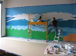 drew heather painting a wall mural