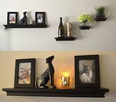 black wooden living room floating shelves with molding black stone dog wall decor silver steel lamp