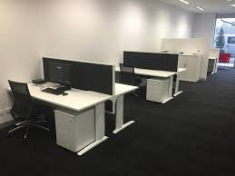 dizzy office furniture. image may contain people sitting screen office table and indoor dizzy furniture t