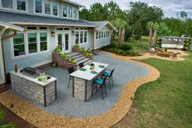 sprawling green outdoor kitchen
