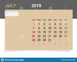 July 2019 Monthly Calendar On Brown Paper And Wood Background