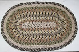 vintage braided oval rug handmade black tan green and brown 34 039
