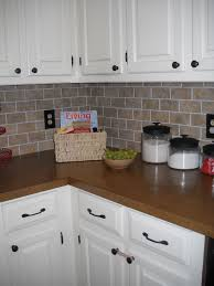 Diy Tile Kitchen Backsplash Our Diy Brick Backsplash Using Vinyl Floor Tiles Cut Into Mini