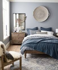 blue grey paint in nordic style bedroom bed covers in diffe shades of blue looking for colors that go