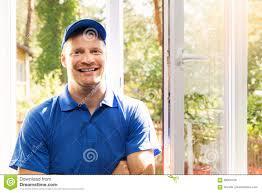 Window Installer In Blue Uniform Standing In The Room Stock