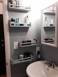 Ikea Bekvam spice racks as bathroom storage.