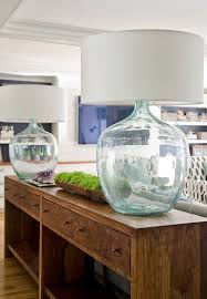 table lamps for living room. modern beach cottage living room features extra-long console table with four drawers topped seeded glass lamps. lamps for