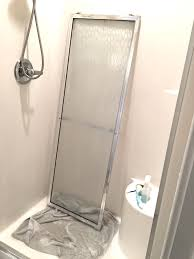 removing shower doors for deep cleaning