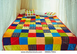 Patchwork Quilt Stock Images, Royalty-Free Images & Vectors ... & Colorful patchwork quilt on the bed Adamdwight.com