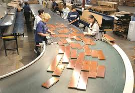 graders inspect the white oak flooring before packaging at mullican file photo johnson city press