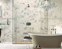 large bathroom features marble tile and standalone tub