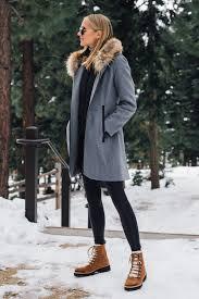blonde woman wearing grey wool coat with faux fur hood spanx black faux leather leggings brown
