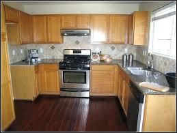 light wood floors with dark cabinets dark kitchen cabinets light floors dark wood floors and light