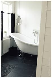 clawfoot bathtubs looks great in any bathroom but especially great in a black and white one