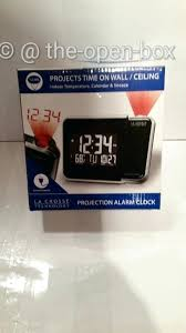 alarm clock projects on ceiling