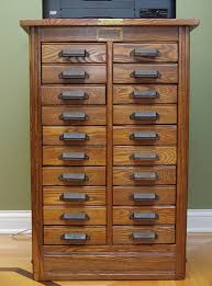need some help identyfing and dating this hamilton cabinet