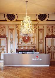 under the high patronage of his majesty the king of the belgians be part of the