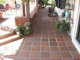 after we had stripped off all of the layers of the dirty grimy sealer deep cleaned the terra cotta tecate tiles grout resealed the pavers with a
