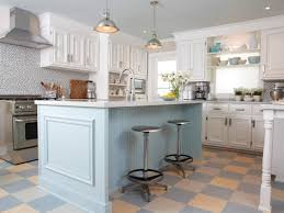 ... White Kitchen Design with Blue Cabinet and Hanging Lamps