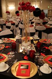 Red, black and gold table decorations for 50th birthday party.