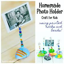 diy rock photo holder craft for kids using painted stones wires and beads