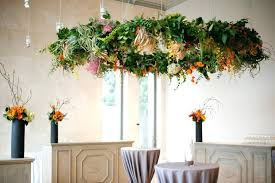 hanging fl chandelier bows and arrows photography fl chandelier of greenery and tropical flowers diy hanging