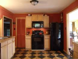 Red Kitchen With Maple Cabinets Black Marble Countertops And