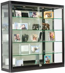 glass display case that is wall mounted illuminated has locking sliding glass doors and ships fully