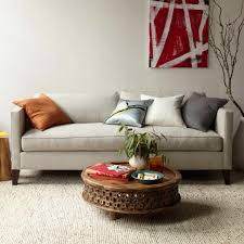 funky living room furniture. stunning image of living room decoration using small white tulip flower coffee table centerpiece along with upholstered light gray fabric sofa funky furniture o