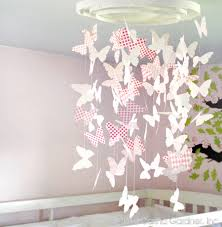 you can use colourful wrapping paper or patterned sbook paper to make the chandelier to match existing