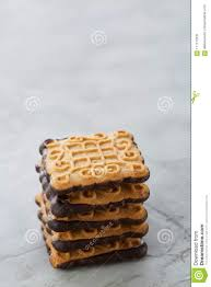 Square Wafer Light Square Biscuits Arranged In Pattern On Light Textured