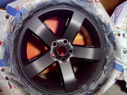 cleaned the wheels really well and wiped them down with lacquer thinner before spraying took 3 coats