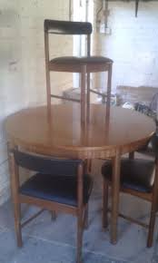 retro teak mcintosh round dining table and 4 tuck under chairs