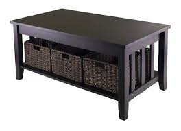 solid black finished coffee table ideas with underneath storage space featuring 3 wicker basket