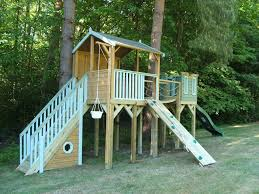 childrens tree house with ramp access and climbing wall