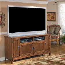 60 Inch Oak TV Stand with Mission Style Hardware by Ashley Furniture ...